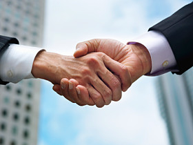 Close-up of hand by which businessman shakes hands